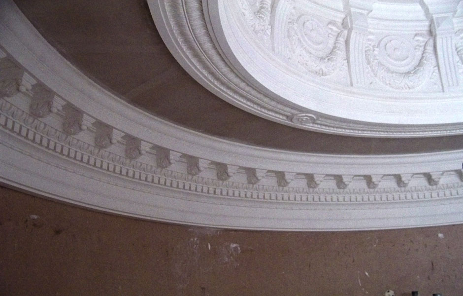Curved end of oval showing modillion cornice
